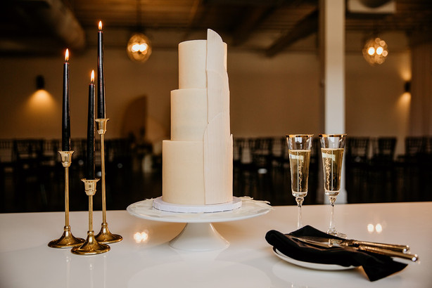 Modern wedding cake with black accents