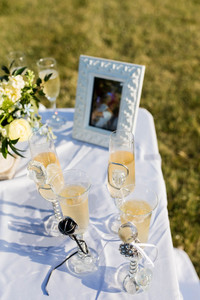 Champagne glasses at outdoor wedding