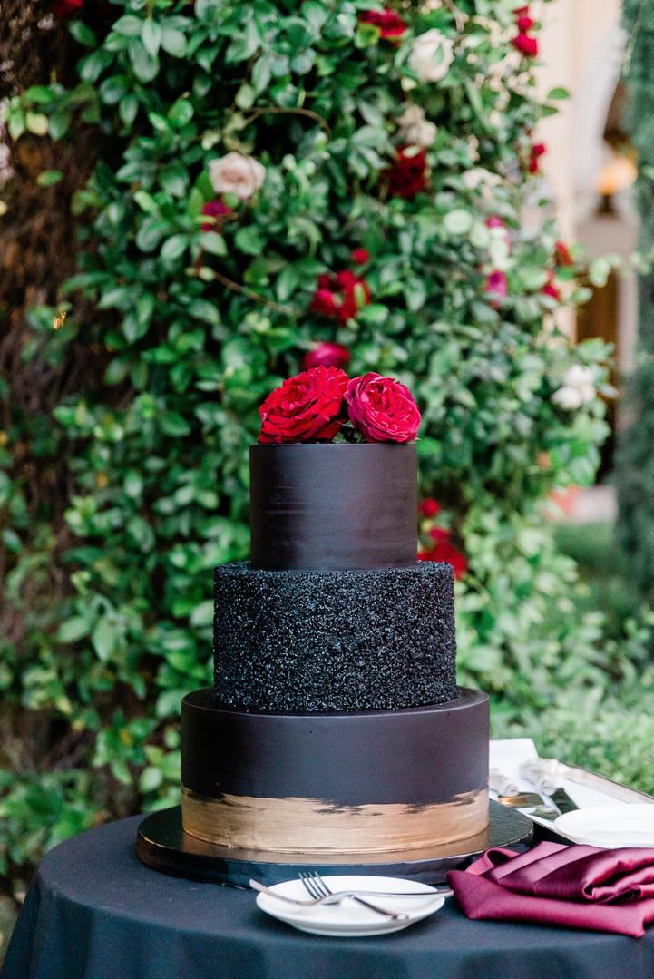Black wedding cake with roses
