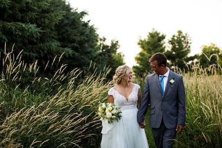 Illinois bride and groom in field