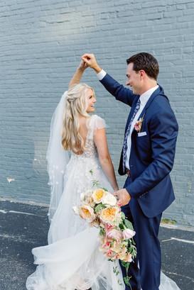 Bride and groom dancing on wedding day