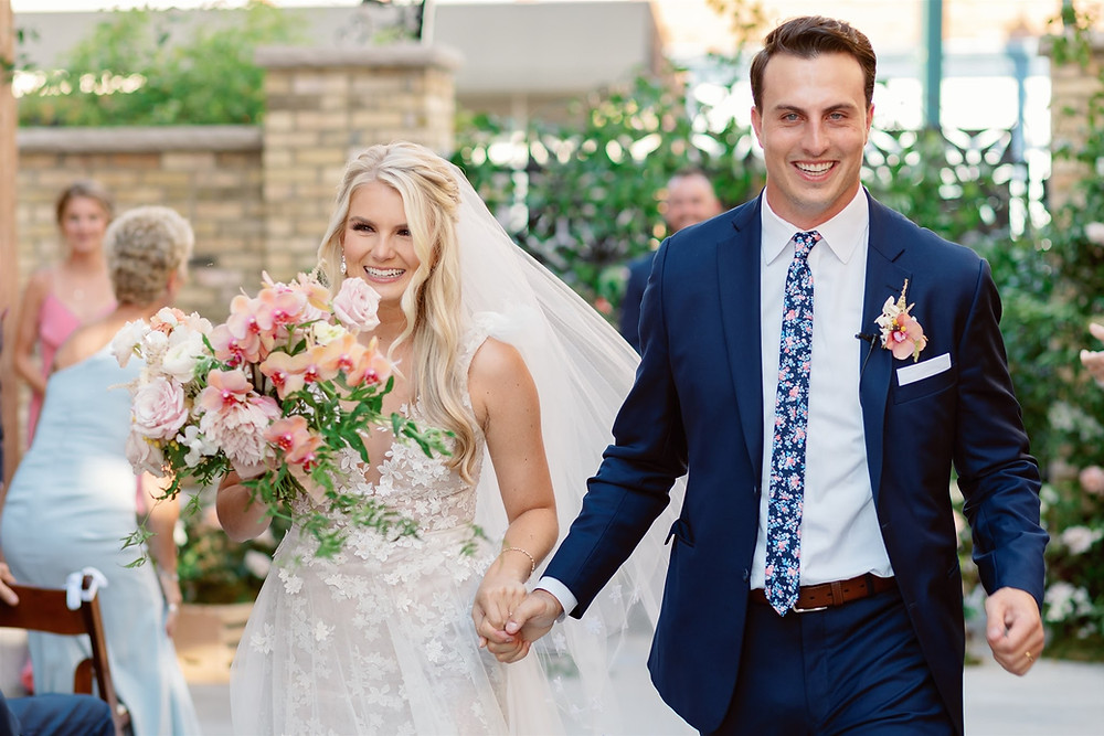 Husband and wife walking down aisle