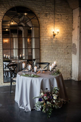 Sweetheart table with brick wall