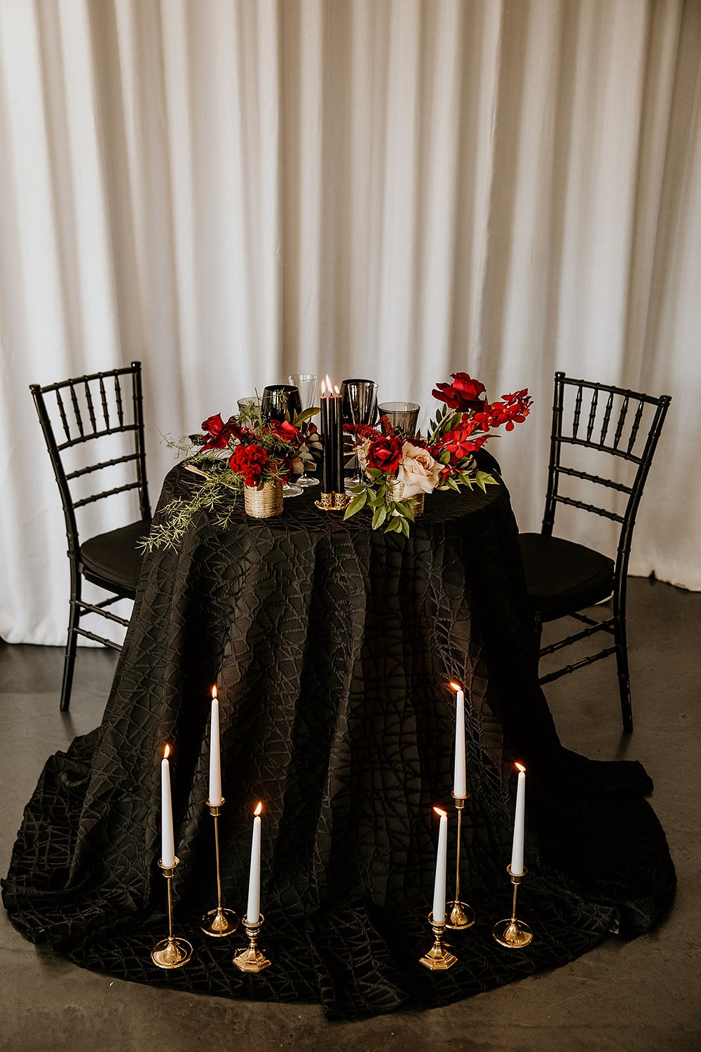Moody sweetheart table with black linen