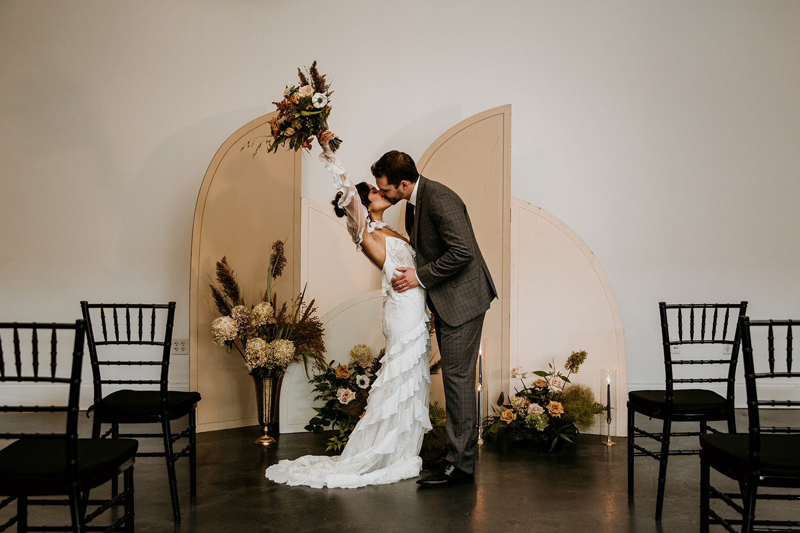 Wedding ceremony with neutral backdrop