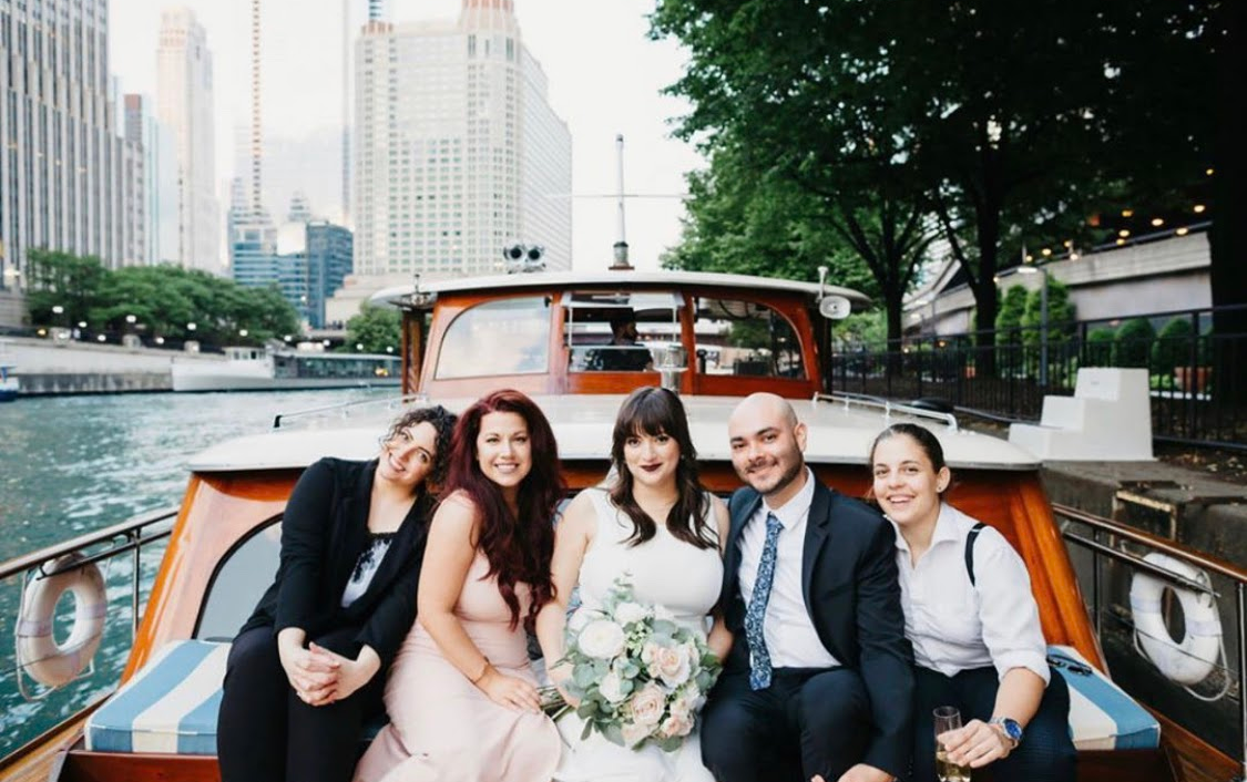 Friends on boat for Chicago wedding