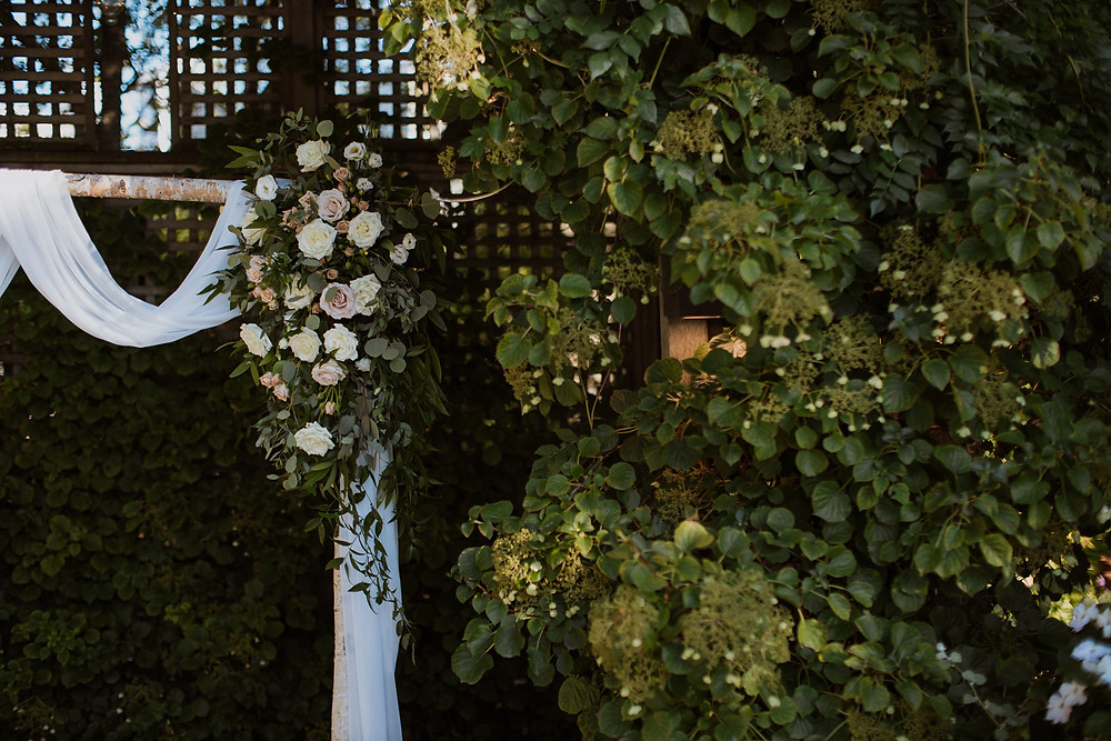 Wedding ceremony arch with floral