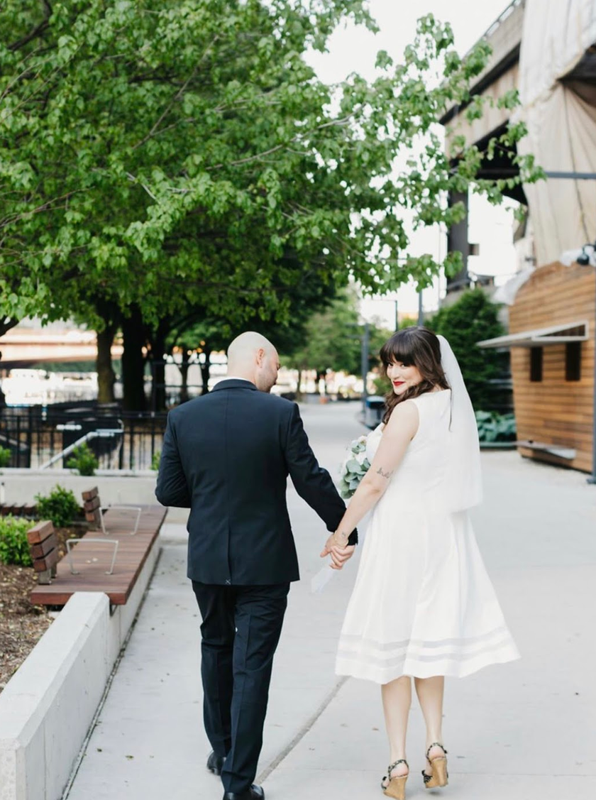 Bride and groom walking in Chicago