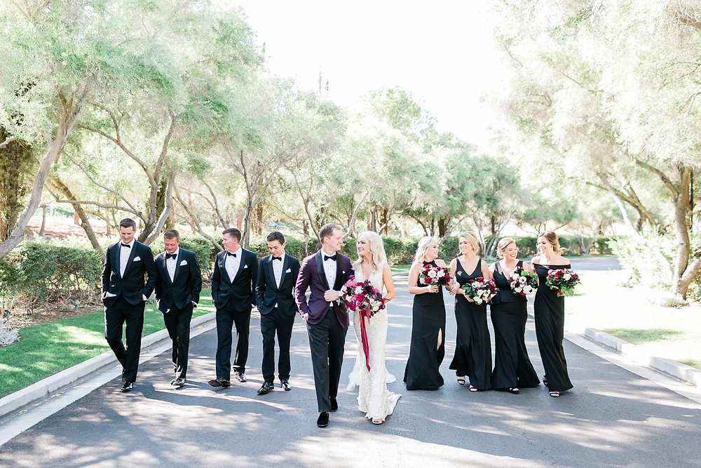 Wedding party in black tuxedos and dresses