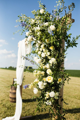 Wedding floral on rustic arch