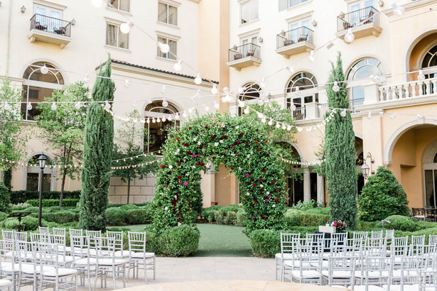 Outdoor wedding ceremony with arch