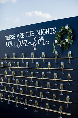 Champagne wall at wedding reception