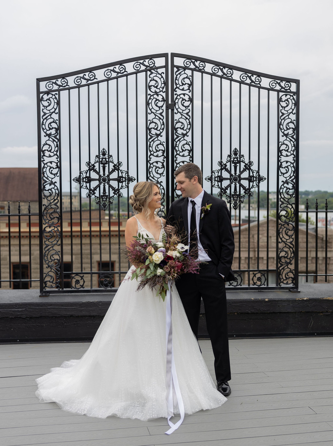 Bride and groom on rooftop in Rockford Illinois