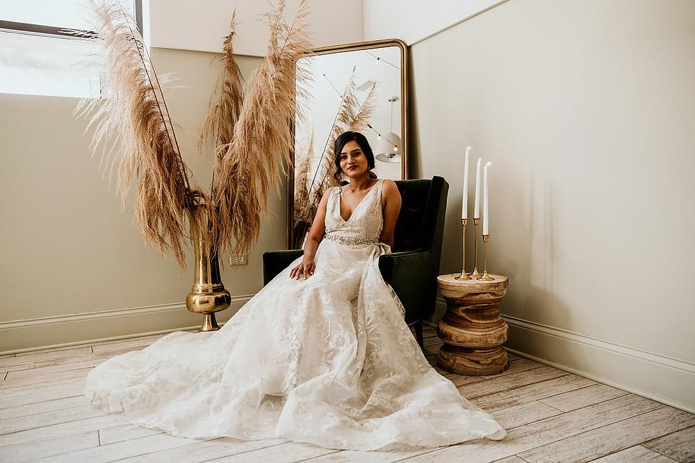 Bride in wedding dress in bridal suite