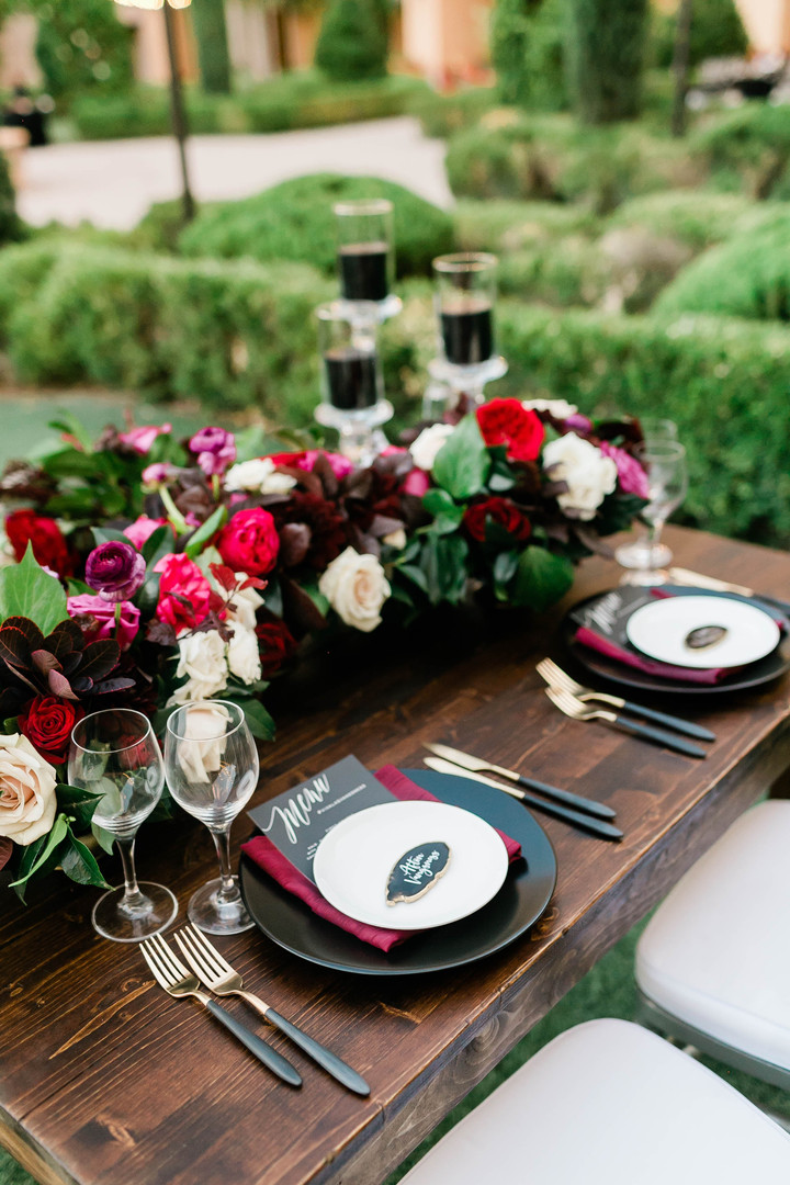 Moody reception table with flowers