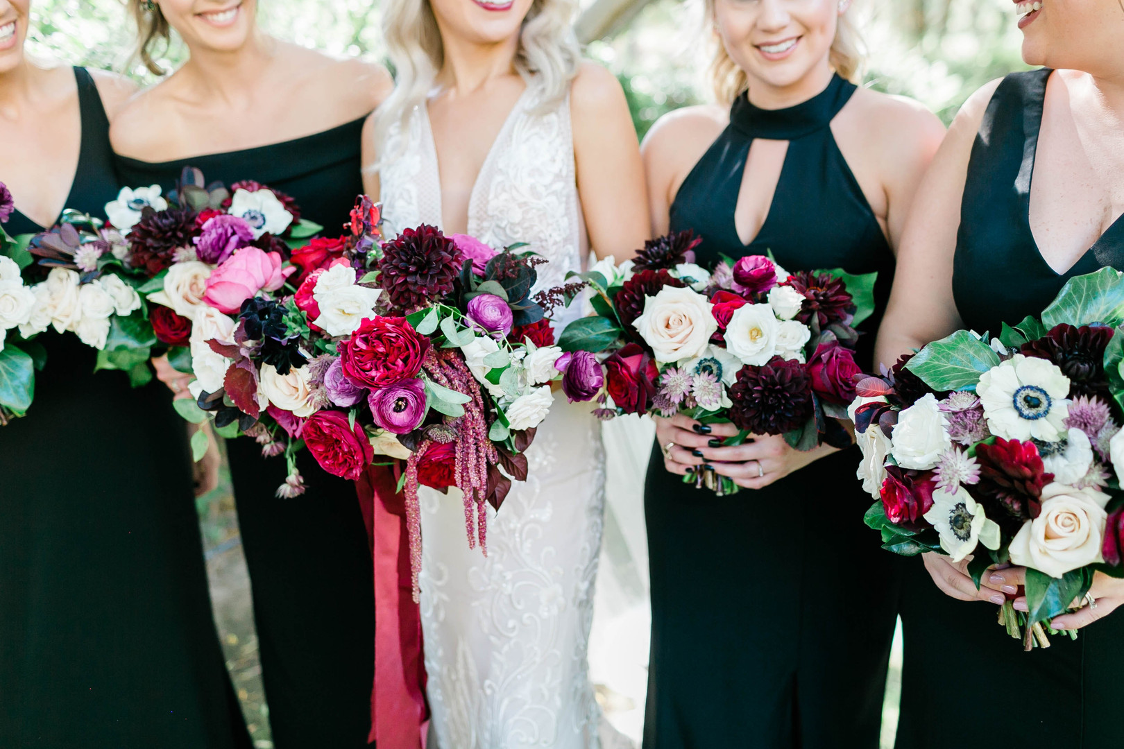 Bold and colorful bouquets with bridesmaids