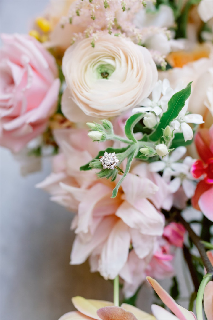 Summer wedding floral with engagement ring