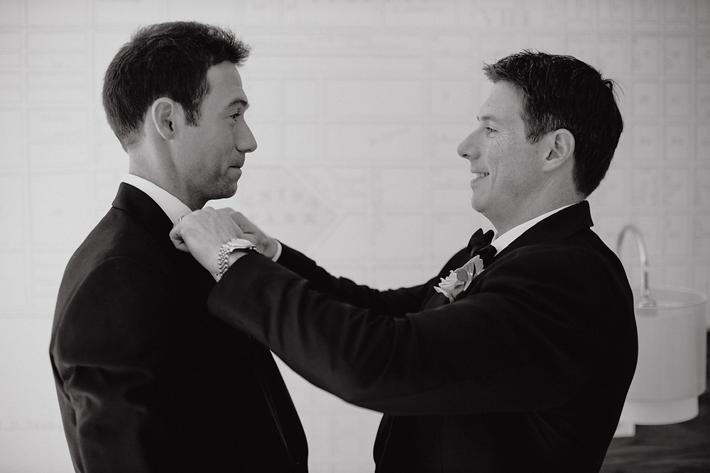 Groom and best man in tuxedos