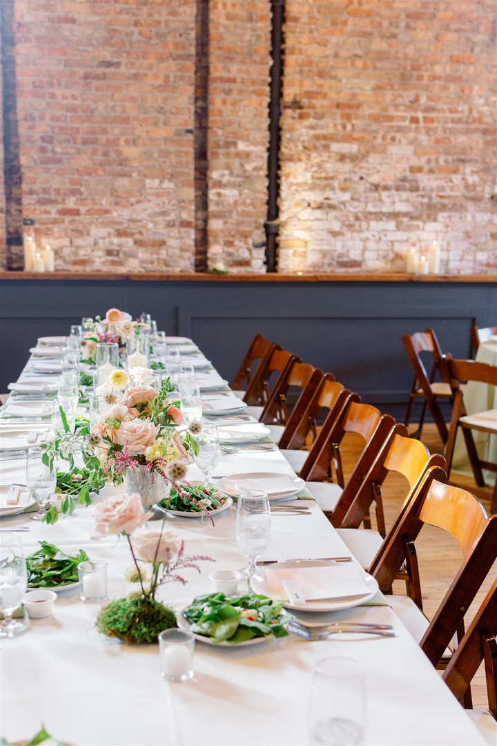 Wedding reception table setting with flowers