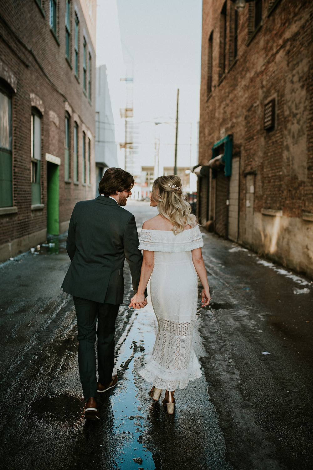 Bride and Groom holding hands in Chicago