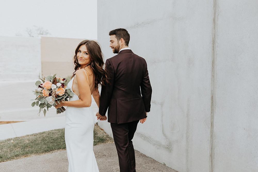 Bride looking over shoulder on wedding day