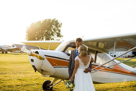 Bride and groom with airplane