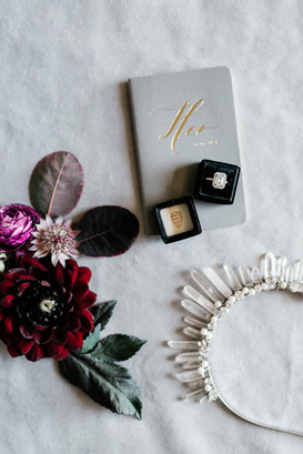 Flatlay with engagement ring and vow book