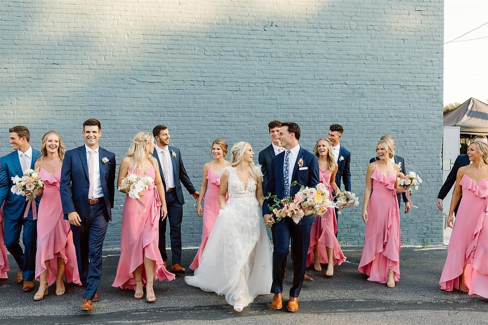 Wedding party walking outside