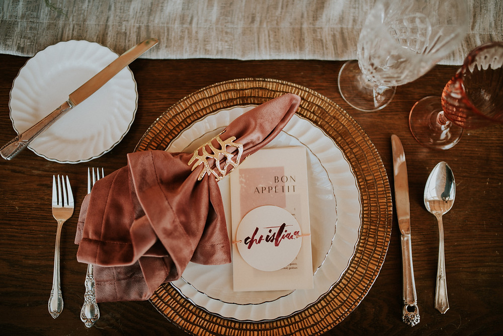 Wedding tablescape with menu cards and velvet napkins