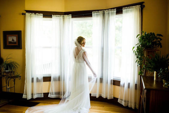 Bride in wedding dress in farmhouse