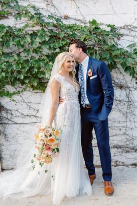 Wedding day photos against ivy wall