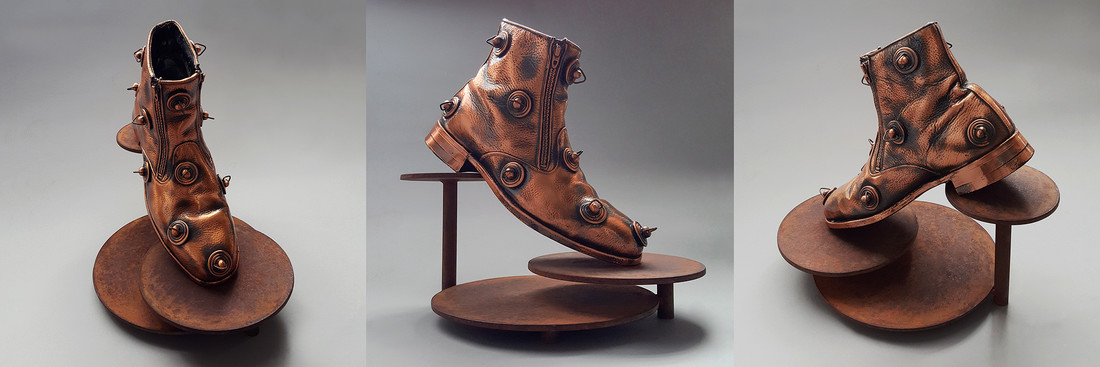 archtypal sculpture, bronze sculpture, surreal sculpture, the fool, the fool's shoe, bronzed shoe, steel sculpture, Cinderella, Paglia, archtype, the fool archtype