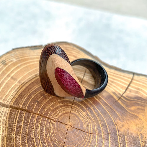 The dancing wood ring in assorted woods
