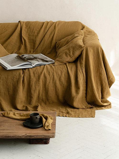 enkelt sengeteppe av gullfarget lin