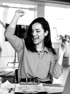 happy-businesswoman-finishing-project_ed