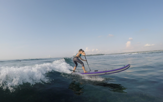 Harmony on the Kharma board SUP Surfing in Bali