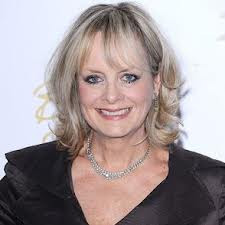 Picture of Twiggy today, smiling, with longer hair, and a little more weight.
