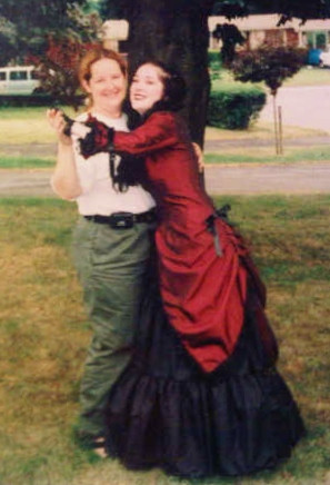 I'm in cargo pants and a t-shirt, and my daughter is wearing a corsetted gown in red and black, and we are dancing on the front lawn.