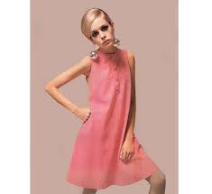 Picture of a young Twiggy, when she was modelling, and very thin, wearing a shift.