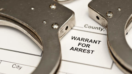 What do I do if there is a warrant for my arrest?