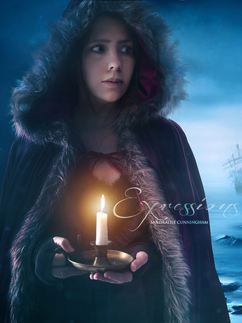 Woman in dark cape holding candle in the