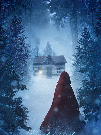 A woman with a red cape walking in a sno
