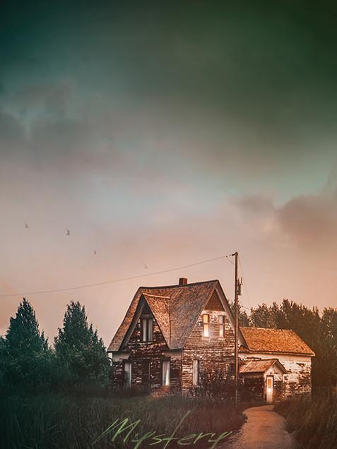 Closeup of farmhouse down a country road