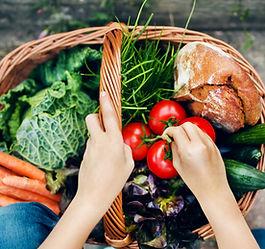 putting vegetables in a basket