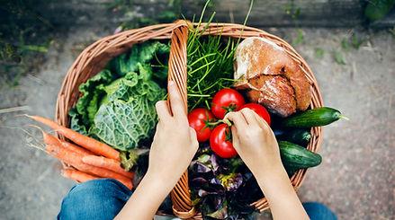A basketof vegetables to represent hospitality