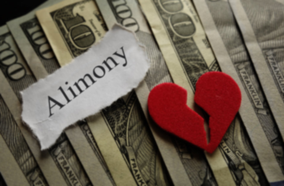 Broken heart with Alimony paper note on