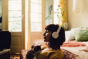 Woman meditating with cat.jpg