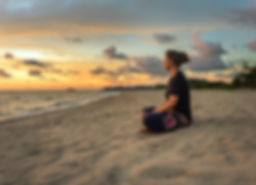 Woman sitting on beach sand and relaxing