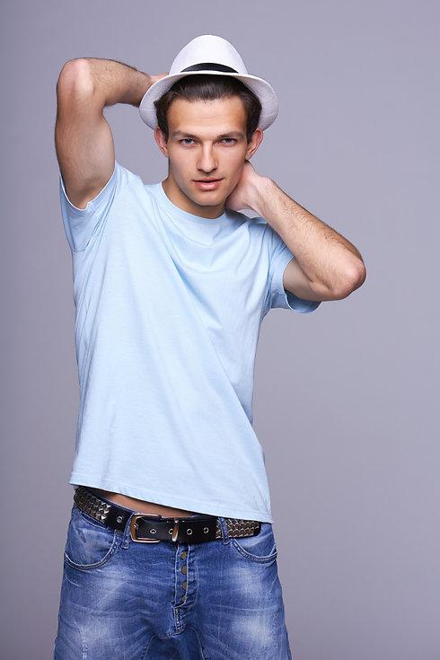 Man fashion model, stylish young man sta