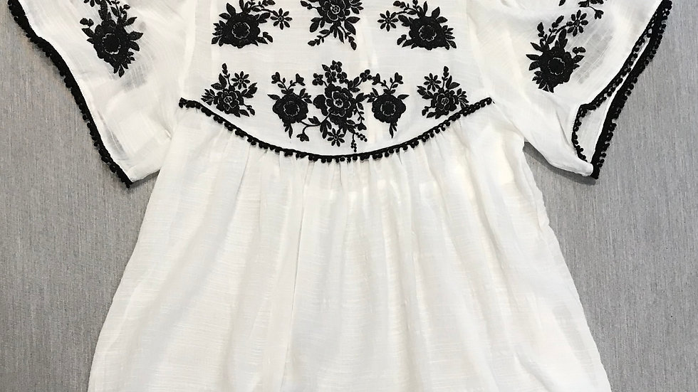 White with Black Embroidery Detail